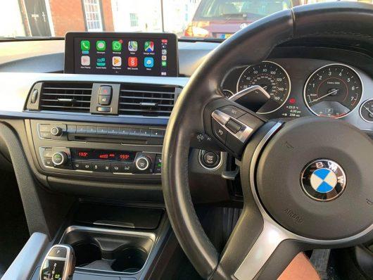 BMW F30 with integrated automotives IMI-1000 retrofit CarPlay